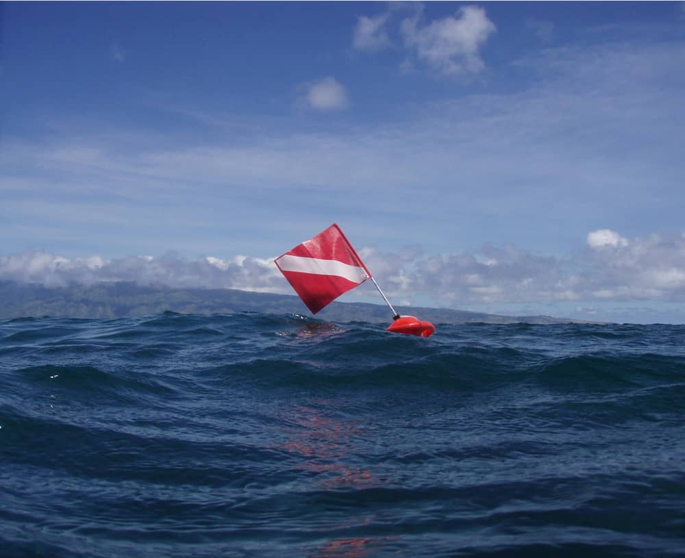 red flag with white diagonal stripe